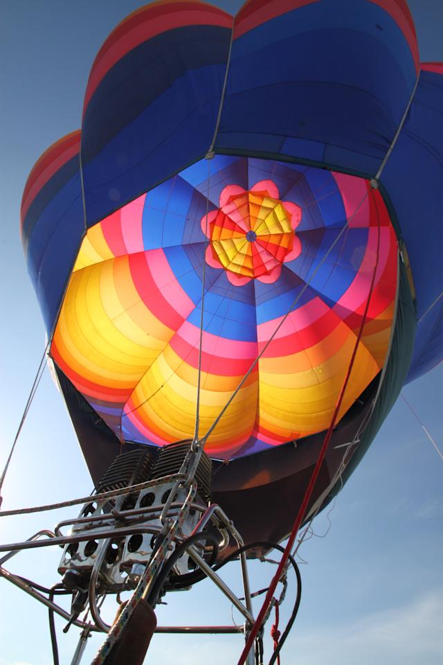 A hot air balloon inflates during the 40th Albuquerque International Balloon Fiesta in Albuquerque, N.M., on Sunday, Oct. 2, 2011. Fiesta organizers said 550 balloons and 600 pilots from around the world are registered for this year's annual event. (AP Photo/Susan Montoya Bryan)