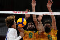 France's Barthelemy Chinenyeze, from left, Brazil's Wallace De Souza and Brazil's Lucas Saatkamp challenge for the ball during the men's volleyball preliminary round pool B match between Brazil and France at the 2020 Summer Olympics, Sunday, Aug. 1, 2021, in Tokyo, Japan. (AP Photo/Frank Augstein)