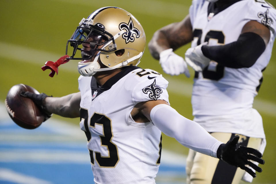 FILE - This file photo from Jan. 3, 2021, shows New Orleans Saints cornerback Marshon Lattimore as he celebrates after an interception during the second half of an NFL football game against the Carolina Panthers in Charlotte, N.C. Lattimore has been arrested there on a weapons charge. A Cleveland police spokesperson says Lattimore was arrested Thursday night, March 25, 2021, in Cleveland after authorities stopped a car he was riding in for traffic violations. (AP Photo/Brian Blanco, File)