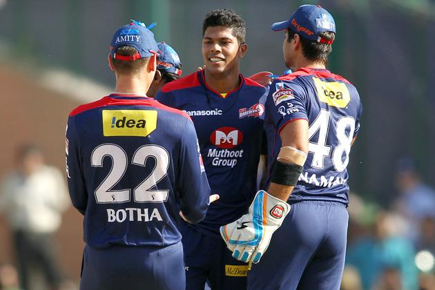 Johan Botha of Delhi Daredevils and Naman Ojha of Delhi Daredevils congratulate Umesh Yadav of Delhi Daredevils for getting Kusal Perera of Rajasthan Royals wicket during match 4 of the Pepsi Indian Premier League between Delhi Daredevils and the Rajasthan Royals held at the Feroz Shah Kotla Stadium, Delhi on the 6th April 2013..Photo by Shaun Roy-IPL-SPORTZPICS ..Use of this image is subject to th