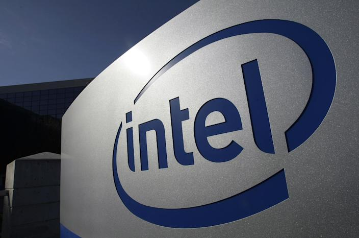 FILE - In this Jan. 12, 2011, file photo, the Intel logo is displayed on the exterior of Intel headquarters in Santa Clara, Calif. Google, Apple, Intel and Adobe Systems announced Thursday, April 24, 2014, they have settled a class-action lawsuit alleging they conspired to prevent their engineers and other highly sought technology workers from getting better job offers from one another. (AP Photo/Paul Sakuma, File)