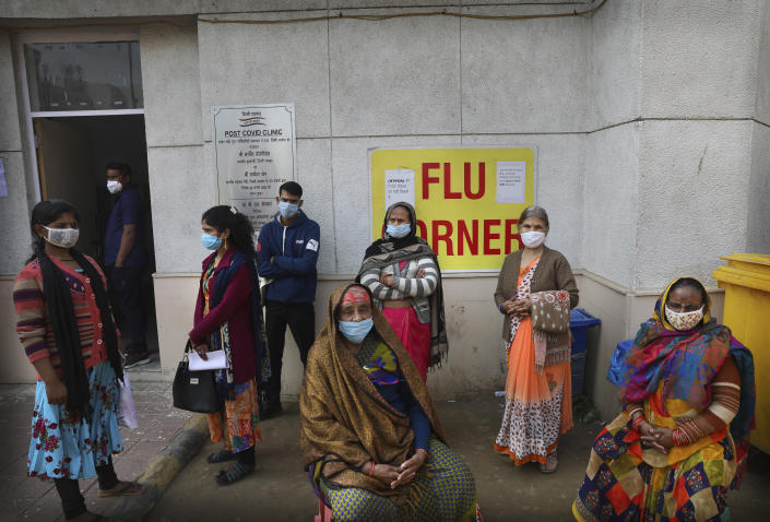 People wait outside a health center to get tested for COVID-19 in New Delhi, India, Thursday, Feb. 11, 2021. When the coronavirus pandemic took hold in India, there were fears it would sink the fragile health system of the world's second-most populous country. Infections climbed dramatically for months and at one point India looked like it might overtake the United States as the country with the highest case toll. But infections began to plummet in September, and experts aren't sure why. (AP Photo/Manish Swarup)
