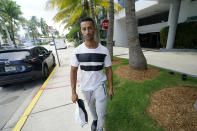 """Gabriel Nir, who lived on the first floor of the Champlain Towers South condo building that collapsed, poses for a portrait outside the hotel where he is now staying in Surfside, Fla., on Friday, July 2, 2021. """"I saw the building turning into a white dust,"""" he says. """"I heard people screaming."""" """"I have to go back. I have to make sure everyone's OK,"""" he said. But he knew it was too late. (AP Photo/Gerald Herbert)"""