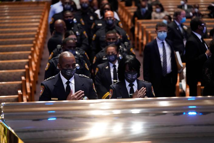Members of the Texas Southern University Police Department pause during a funeral service for George Floyd at the Fountain of Praise Church in Houston on Tuesday. (David J. Phillip/AFP via Getty Images)