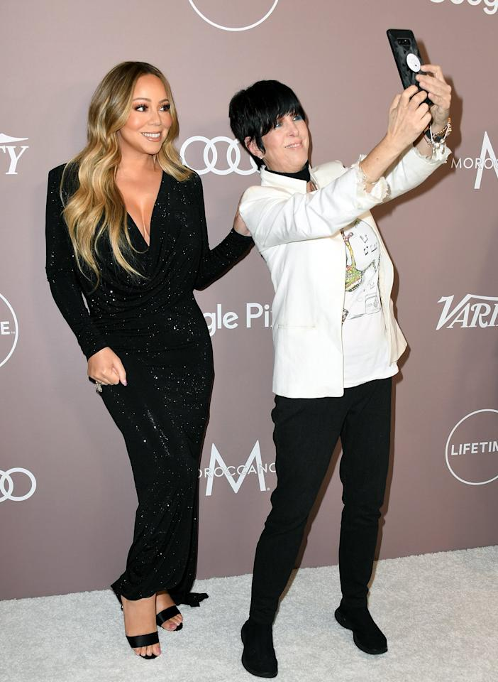 Meanwhile on the Power of Women red carpet, songstresses Mariah Carey and Diane Warren snap a selfie.