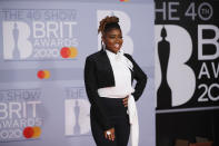 Radio DJ, Clara Amfo's tapered suit has been tailored in the best way possible with bell bottom trousers, too. (Getty Images)