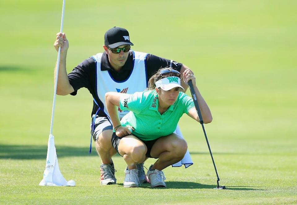 Gerina Piller looks over the 10th green with her caddie Brian Dilley during the third round of the Texas Shootout at Las Colinas Country Club on April 30, 2016 in Irving, Texas (AFP Photo/Scott Halleran)