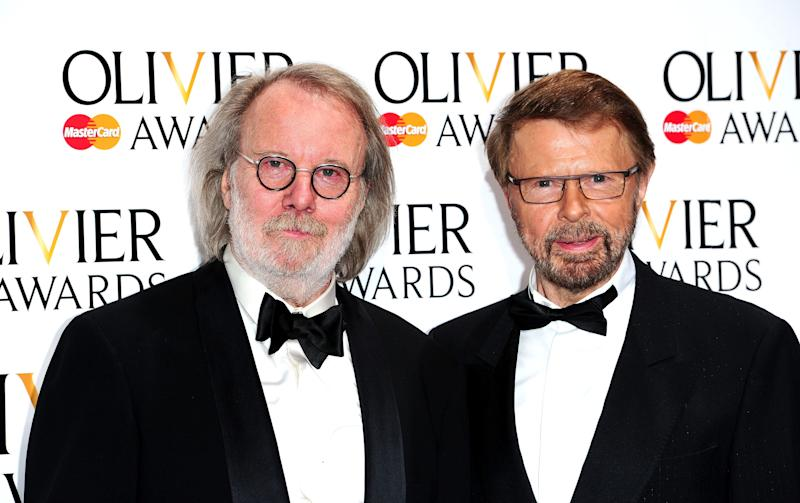 Two of the original members of the pop group ABBA, Benny Anderson, left, and Bjorn Ulvaeus at the Royal Opera House in London Sunday April 13, 2014. Named after the British actor Laurence Olivier, the awards are given for productions staged in London. (AP Photo / Ian West, PA) UNITED KINGDOM OUT - NO SALES - NO ARCHIVES