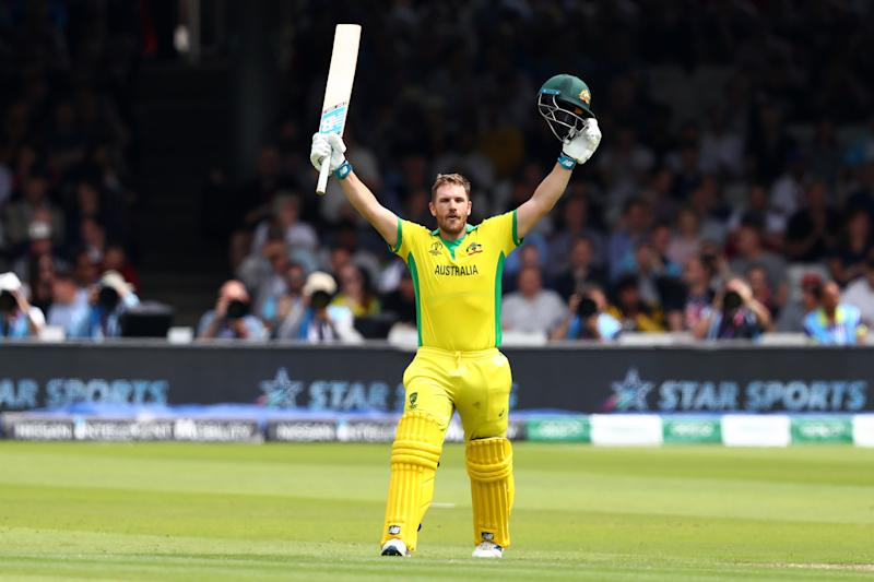 Aaron Finch of Australia celebrates reaching his century. (Credit: Getty Images)
