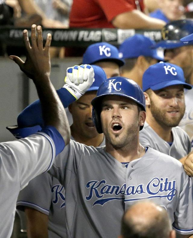 Kansas City Royals' Mike Moustakas celebrates his two-run home run off Chicago White Sox relief pitcher Eric Surkamp, also scoring Alex Gordon, during the eighth inning of a baseball game Tuesday, July 22, 2014, in Chicago. (AP Photo/Charles Rex Arbogast)