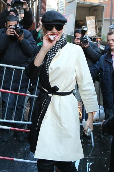"""The singer, who recently apologized for her music video """"Looking Hot"""" over racism claims, looks a bit like a mime in a black and white ensemble. She complements her coat with a matching polka dot scarf, black hat and dark sunnies. It could come off as too twee but she pulls it off effortlessly. Picture by: KCS / Splash News"""