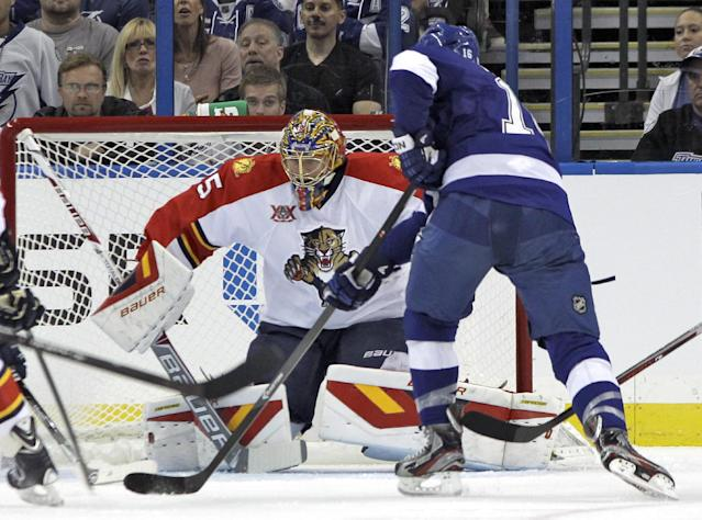 Florida Panthers goalie Jacob Markstrom (25), of Sweden, stops a shot by Tampa Bay Lightning right wing Teddy Purcell (16) during the first period of an NHL hockey game Thursday, Oct. 10, 2013, in Tampa, Fla. (AP Photo/Chris O'Meara)