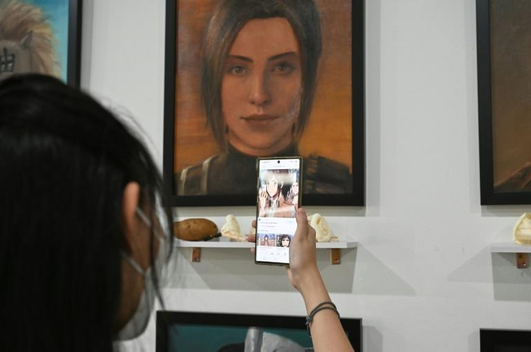 """Sasha Braus, a character from Attack on Titan, had a potato left on her shelf -- a reference to her nickname """"Potato Girl"""", for her love of food"""