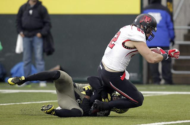 Utah receiver Jake Murphy, right, is brought down by Oregon defender Avery Patterson on his way to scoring on a reception during the first half of an NCAA college football game in Eugene, Ore., Saturday, Nov. 16, 2013. (AP Photo/Don Ryan)
