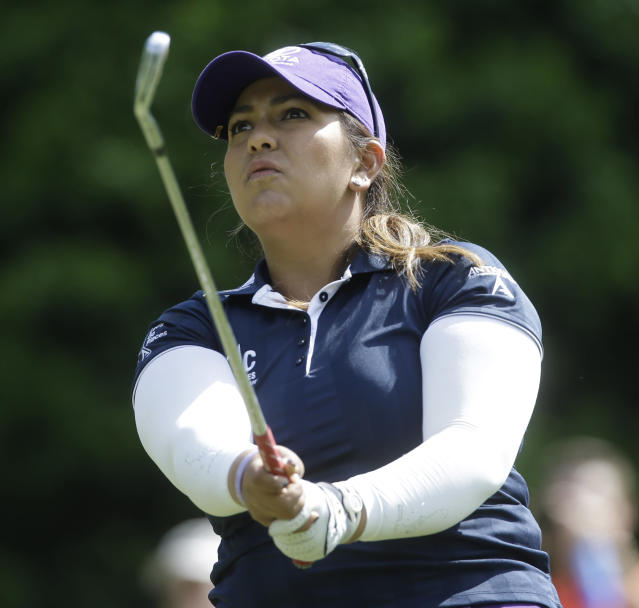 Lizette Salas watches her tee shot not eh fifth hole during the final round of the Kingsmill Championship golf tournament at the Kingsmill resort in Williamsburg, Va., Sunday, May 18, 2014. Salas birdied the par-3 hole. (AP Photo/Steve Helber)