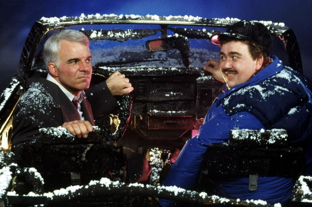"""<a href=""""http://movies.yahoo.com/movie/1800106616/info"""">PLANES, TRAINS AND AUTOMOBILES</a>   Starting Point: New York   Ending Point: Chicago by away of Wichita   Goal: To get home by Thanksgiving   Snags: Weather, implacable car rental company employees, pillows. Wait... those aren't pillows!"""