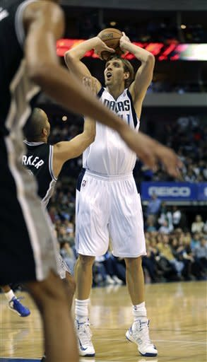 Dallas Mavericks forward Dirk Nowitzki (41), of Germany, takes a shot during the first half of an NBA basketball game against the San Antonio Spurs in Dallas on Sunday, Dec. 30, 2012. (AP Photo/Mike Fuentes)