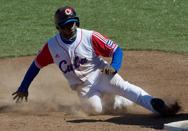 Rusney Castillo, a Cuban outfielder who defected to Haiti six months ago, agrees to a record Major League Baseball contract with the Boston Red Sox, multiple reports say
