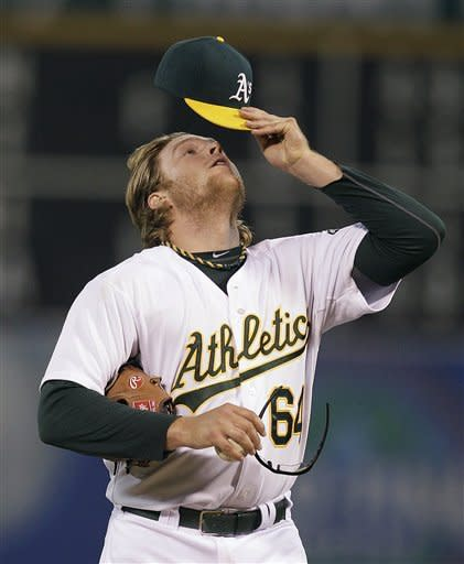 Oakland Athletics' A.J. Griffin adjusts his cap in the first inning of a baseball game against the Seattle Mariners on Friday, Sept. 28, 2012, in Oakland, Calif. (AP Photo/Ben Margot)