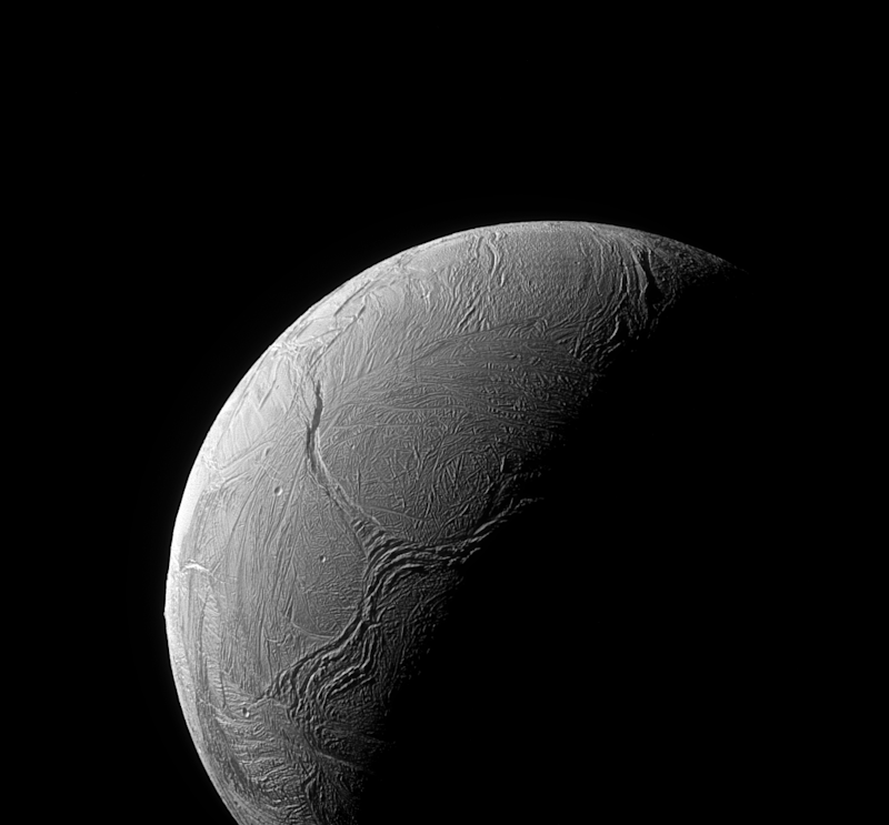A sinuous feature snakes northward from the north pole of Saturn's sixth biggest moon, Enceladus, like a giant tentacle on Feb. 15, 2016.