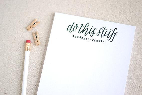 """Do This Stuff Notepad; $10 at <a href=""""https://www.etsy.com/listing/170950992/hand-lettered-recycled-notepad-to-do?ref=sr_gallery_27&ga_search_query=notepad&ga_page=10&ga_search_type=all&ga_view_type=gallery"""" rel=""""nofollow noopener"""" target=""""_blank"""" data-ylk=""""slk:etsy.com"""" class=""""link rapid-noclick-resp""""><em>etsy.com</em></a>"""