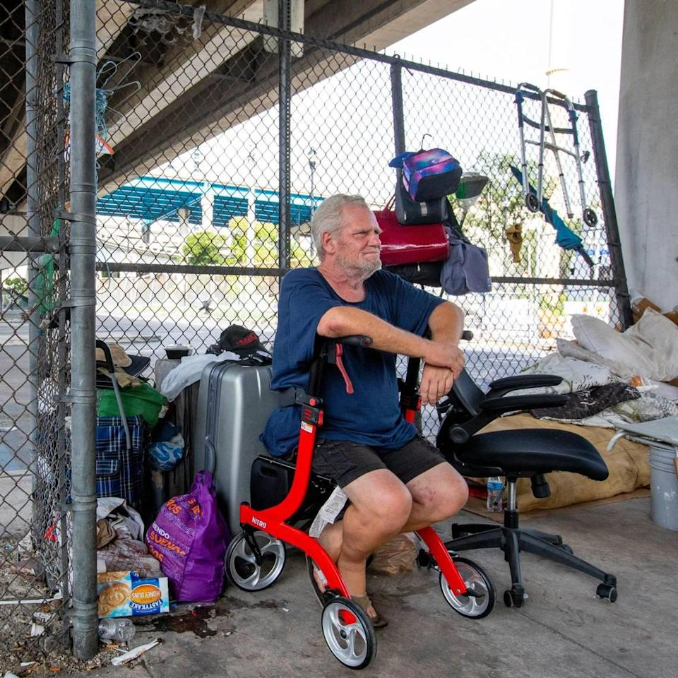 Jeffrey Snow, a former Booker T. Washington math teacher who lacks housing, sits underneath the I-95 expressway off Southwest 1st street and Southwest Second Avenue in Miami, Florida, on Monday, September 20, 2021.