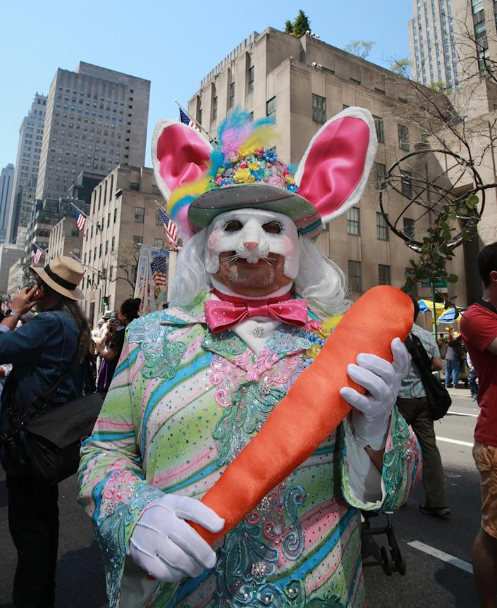 <p>Jesus from Puerto Rico walks softly and carries a big carrot dressed as the Easter bunny during the 2017 New York City Easter Parade on April 16, 2017. (Photo: Gordon Donovan/Yahoo News) </p>