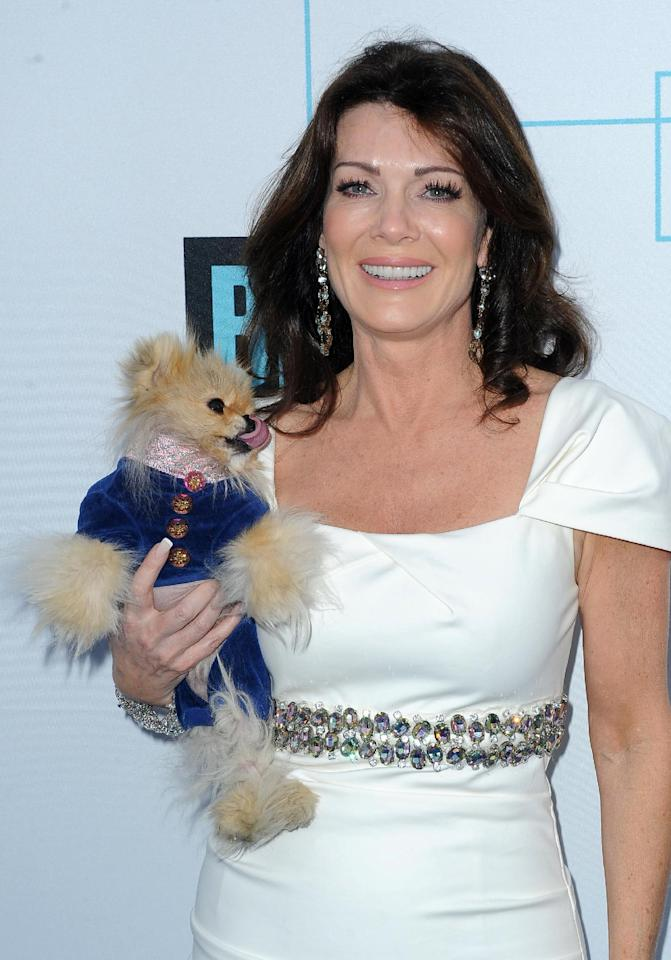 """FILE - In this March 30, 2011 file photo, Lisa Vanderpump from """"The Real Housewives of Beverly Hills,"""" arrives at the Bravo Media's 2011 upfront presentation with her dog Giggy, at The Roosevelt Hotel in Los Angeles, Calif. Bravo announced at its upfront presentation Wednesday, April 4, 2012, that Vanderpump will get her own reality show centered around the inner-workings of her new Hollywood restaurant, SUR. (AP Photo/Katy Winn, file)"""