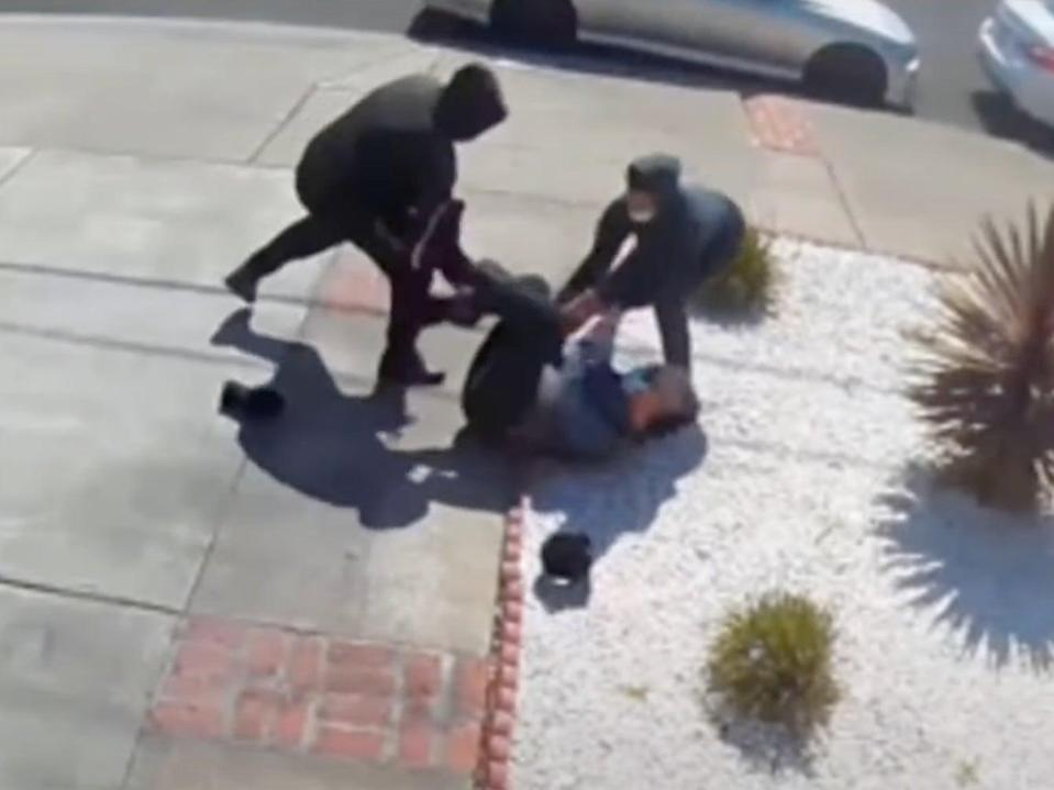 An 80-year-old Asian man was attacked and had his Fitbit stolen as teens attacked him in San Leandro, near San Francisco.  (Home security video/NBC Bay Area)