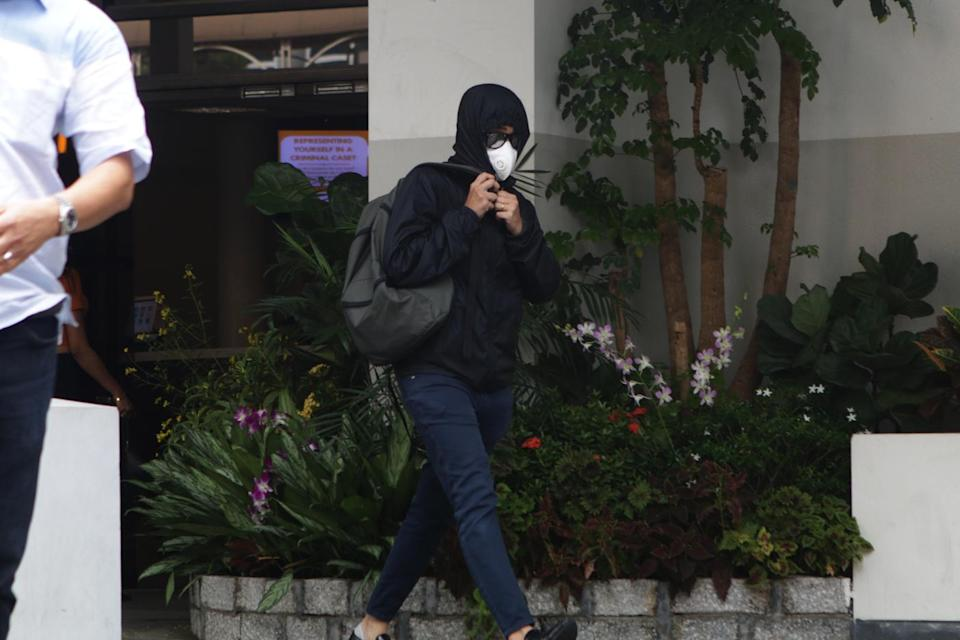 One of the disguised men seen leaving the State Courts on Wednesday (31 October) morning following the charging of SAF Captain Tan Baoshu. (PHOTO: Dhany Osman / Yahoo News Singapore)