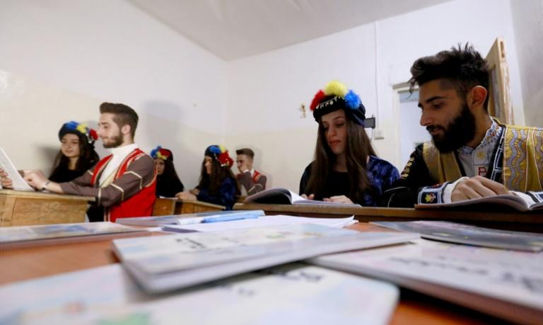 Students from the Syriac Christian minority attend a class in Qamishli