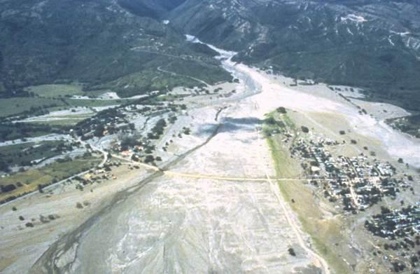 This aerial photo from December 9, 1985, nearly a month after the event, shows the devastating debris flows that swept down from Colombia's Nevado del Ruiz volcano.