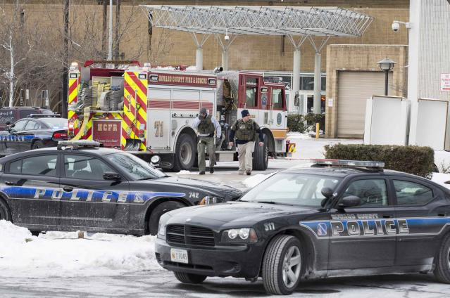 Armed police leave an entrance of the Columbia Mall after a shooting at the mall in Columbia, Maryland, January 25, 2014. Three people died in a shooting at a large shopping mall outside Baltimore on Saturday, police said, adding that the suspected gunman apparently killed himself. REUTERS/Joshua Roberts (UNITED STATES - Tags: CRIME LAW CIVIL UNREST)