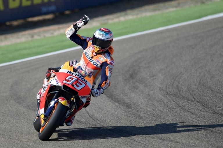 Honda's Spanish rider Marc Marquez greets fans after the third free pratice for the Moto Grand Prix of Aragon at the Motorland circuit in Alcaniz, Spain on September 23, 2017