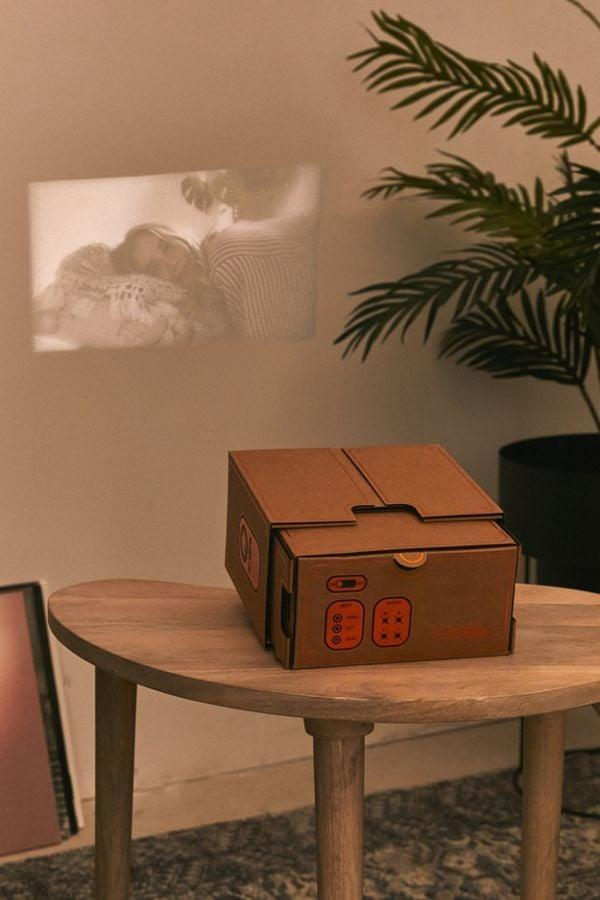 """<p>Project your favorite movie anywhere with this <a href=""""https://www.popsugar.com/buy/Smartphone-Projector-20-395315?p_name=Smartphone%20Projector%202.0&retailer=urbanoutfitters.com&pid=395315&price=30&evar1=news%3Aus&evar9=36026397&evar98=https%3A%2F%2Fwww.popsugar.com%2Fnews%2Fphoto-gallery%2F36026397%2Fimage%2F45606030%2FSmartphone-Projector-20&list1=gifts%2Cgadgets%2Choliday%2Cgift%20guide%2Cdigital%20life%2Ctech%20gifts%2Cgifts%20for%20men&prop13=api&pdata=1"""" class=""""link rapid-noclick-resp"""" rel=""""nofollow noopener"""" target=""""_blank"""" data-ylk=""""slk:Smartphone Projector 2.0"""">Smartphone Projector 2.0</a> ($30).</p>"""