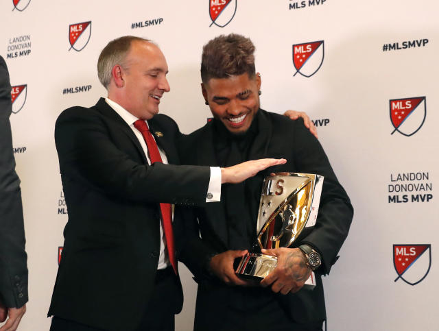Atlanta United soccer player Josef Martinez, right, jokes with team president Darren Eales after it was announced that Martinez was the winner of the Landon Donovan MLS MVP award, Wednesday, Dec. 5, 2018, in Atlanta. (AP Photo/John Bazemore)