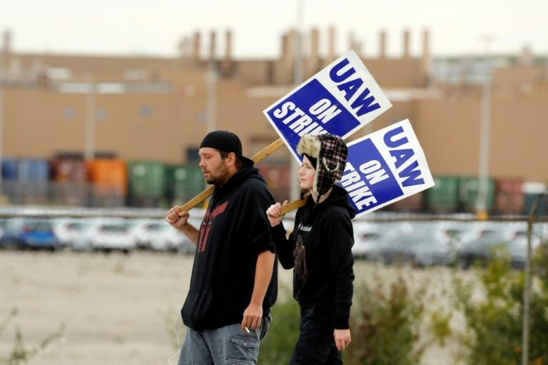 Workers walk the picket line outside General Motors Orion Assembly on October 11 in Orion Township, Michigan (AFP Photo/JEFF KOWALSKY)