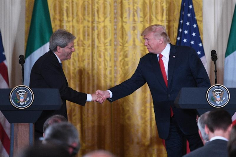 US President Donald Trump shakes hands with Italian Prime Minister Paolo Gentiloni during a joint press conference at the White House in Washington, DC, April 20, 2017