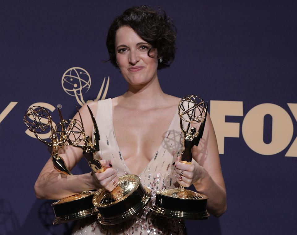 """71st Primetime Emmy Awards - Photo Room – Los Angeles, California, U.S., September 22, 2019 - Phoebe Waller-Bridge poses backstage with her Outstanding Leading Actress in a Comedy Series and Outstanding Writing for a Comedy Series awards for """"Fleabag"""". REUTERS/Monica Almeida"""