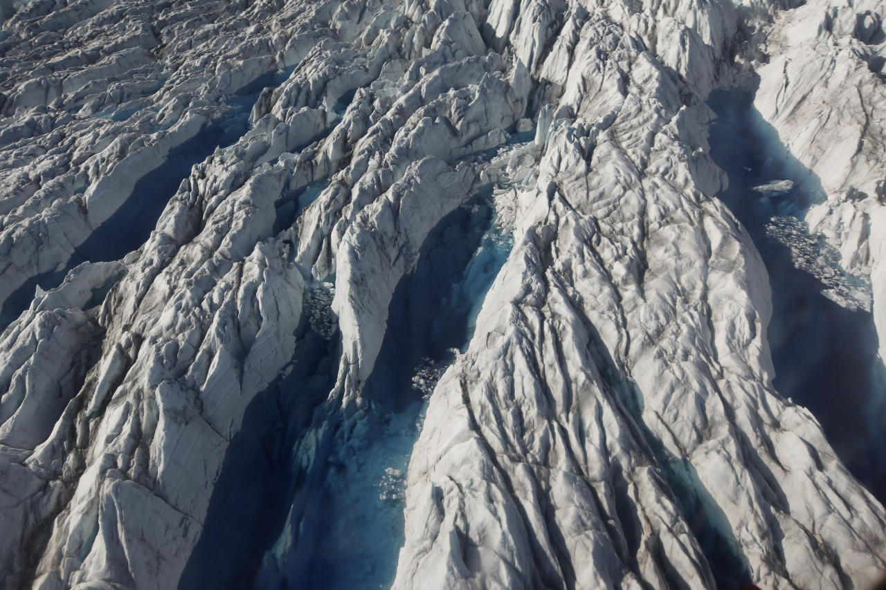 In this July 19, 2011 photo, pools of melted ice form atop Jakobshavn Glacier, near the edge of the vast Greenland ice sheet. Greenland is the focus of many researchers trying to determine how much its melting ice may raise sea levels. (AP Photo/Brennan Linsley)