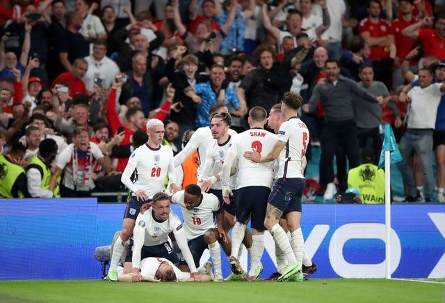 Harry Kane is mobbed by team-mates after scoring the goal that took England to the final