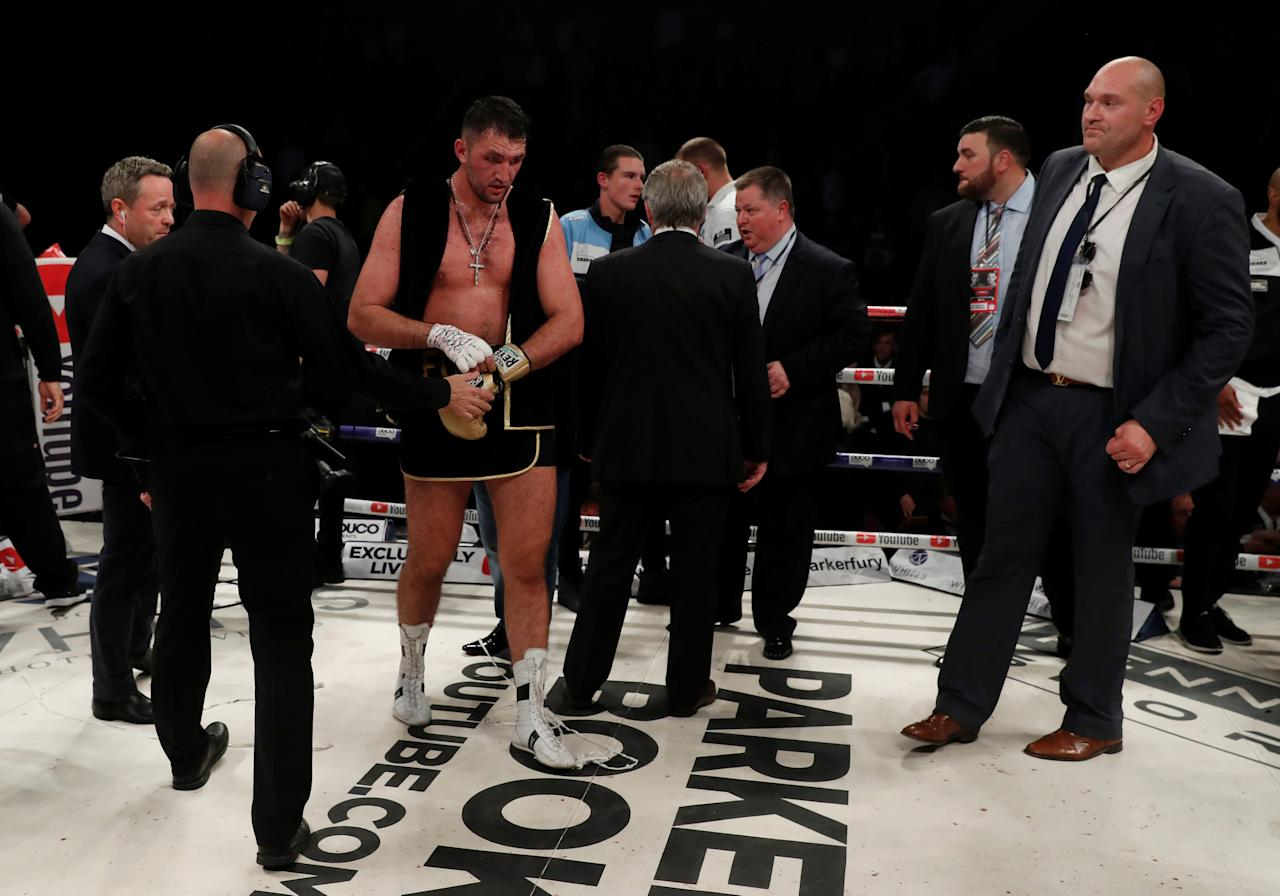 Boxing - Joseph Parker vs Hughie Fury - WBO World Heavyweight Title - Manchester Arena, Manchester, Britain - September 23, 2017   Hughie Fury looks dejected after losing the fight as Tyson Fury looks on   Action Images via Reuters/Andrew Couldridge