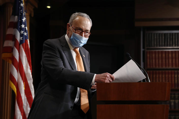 Senate Minority Leader Sen. Chuck Schumer of N.Y., center, arrives for a news conference on Capitol Hill in Washington, Tuesday, May 12, 2020. (AP Photo/Patrick Semansky)