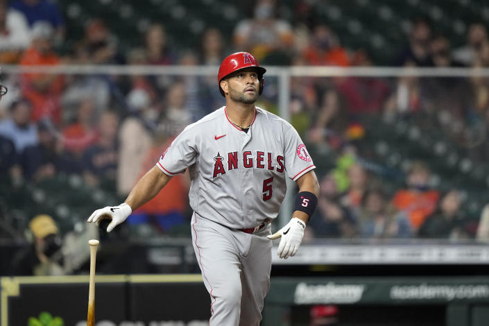 Los Angeles Angels' Albert Pujols watches his two-run home run against the Houston Astros during the sixth inning of a baseball game Thursday, April 22, 2021, in Houston. (AP Photo/David J. Phillip)