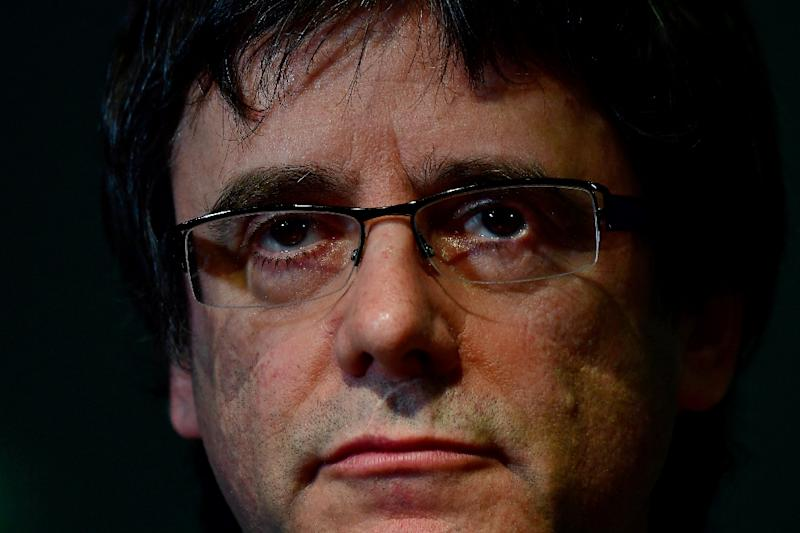 In theory, Puigdemont could remain in self-exile for 20 years, which in Spain's legal system is the time limit after which the rebellion charge is no longer valid (AFP Photo/Tobias SCHWARZ)