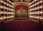 """<p>Having opened in 1737, the <a href=""""https://www.teatrosancarlo.it/en/"""" rel=""""nofollow noopener"""" target=""""_blank"""" data-ylk=""""slk:Teatro Reale di San Carlo"""" class=""""link rapid-noclick-resp"""">Teatro Reale di San Carlo</a> is the oldest continuously active opera house in the world. It was commissioned by the Bourbon King Charles III of Naples and designed by Giovanni Antonio Medrano, a military architect, and Angelo Carasale, the former director of the San Bartolomeo. The horseshoe-shaped auditorium's interior is adorned with neoclassical motifs, including bas relief sculptures throughout. The facade is heavily rusticated on the ground level and features an Ionic colonnade on the second level.</p>"""