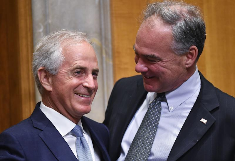 Senate Foreign Relations Committee Chairman Bob Corker (R-Tenn.), left, and Sen. Tim Kaine (D-Va.) on Capitol Hill in June 2016. The senators unveiled a new authorization for use of military force on Monday. (MANDEL NGAN via Getty Images)