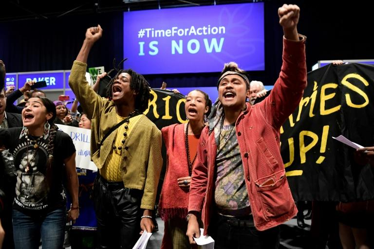 The slogan of the 2019 installment of annual climate talks is 'Time for Action' (AFP Photo/CRISTINA QUICLER)