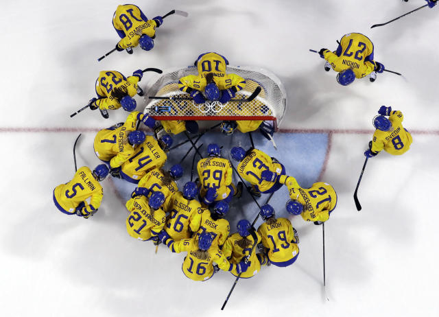 FILE - In this Feb. 2, 2018, file photo, players from Sweden gather before the preliminary round of the women's hockey game against the combined Koreas at the 2018 Winter Olympics in Gangneung, South Korea. The leading female hockey players in Sweden were refusing to attend a training camp Thursday or play in an upcoming international tournament in Finland over a pay dispute with the countrys federation. The Swedish Ice Hockey Federation said it has been informed of the boycott and is surprised at the decision.(AP Photo/Kiichiro Sato, File)