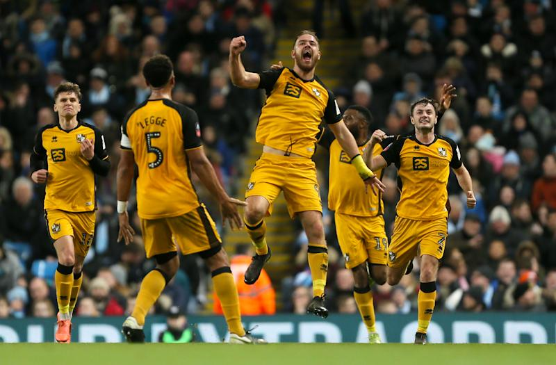 Port Vale's Tom Pope celebrates scoring his side's first goal of the game. (Credit: Getty Images)
